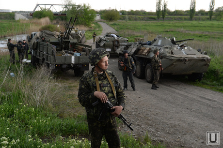 Civil block military equipment between Kramatorsk and Slavonic. Ukraine, military vehicles, soldiers, Ukrainian army